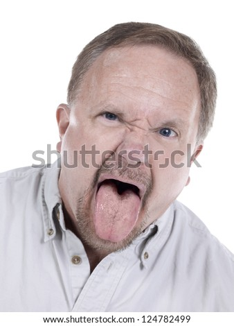 Portrait of a senior man with his tongue out on a white background - stock photo