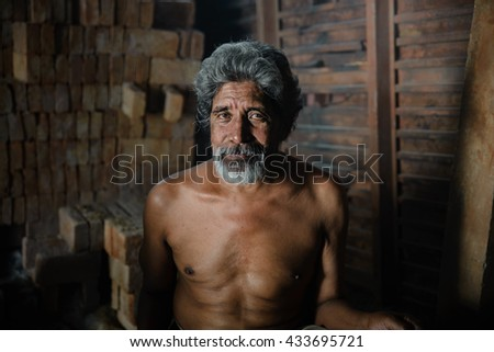 Portrait of a Senior man worker - stock photo