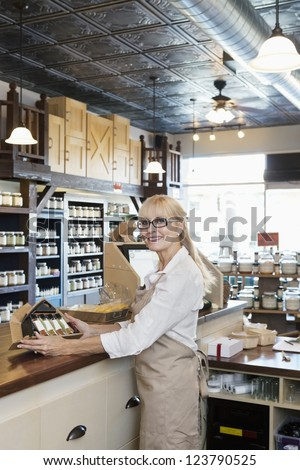 Portrait of a senior spice merchant standing at counter in store - stock photo