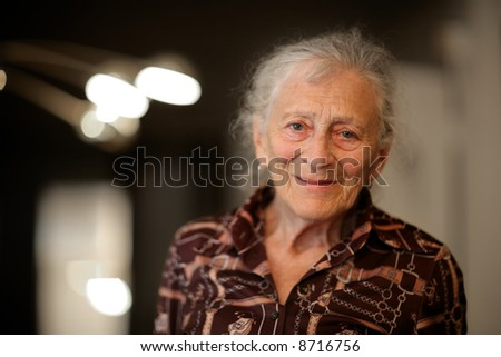 Portrait of a senior woman at home - stock photo