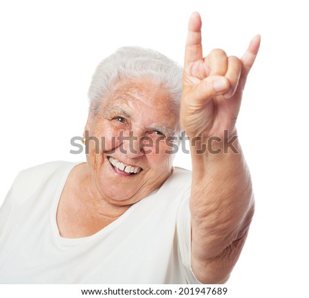portrait of a senior woman doing a rock gesture - stock photo