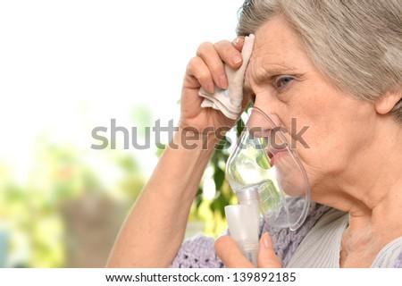 Portrait of a senior woman feel unwell - stock photo