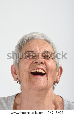 Portrait of a senior woman, laugh - stock photo