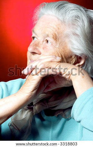 Portrait of a senior woman looking away - stock photo