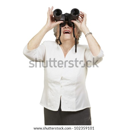 portrait of a senior woman looking through binoculars against a white background - stock photo