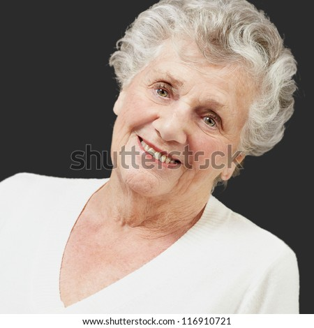 Portrait Of A Senior Woman On Black Background - stock photo