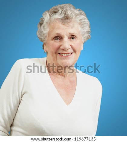 Portrait Of A Senior Woman On Blue Background - stock photo