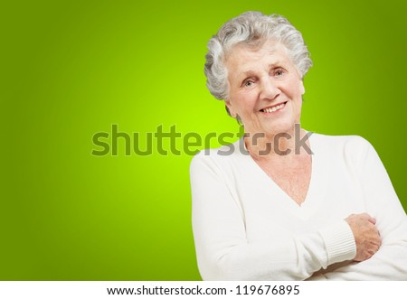 Portrait Of A Senior Woman On Green Background