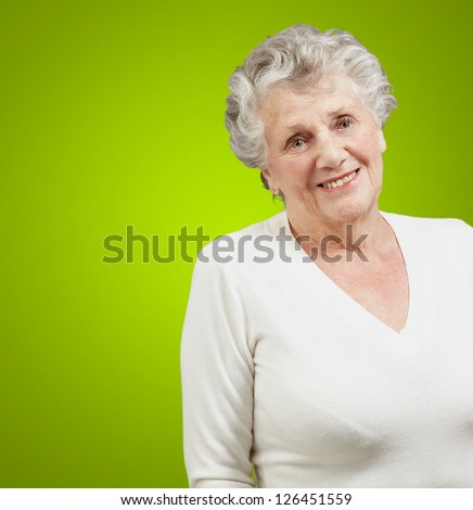 Portrait Of A Senior Woman On Green Background - stock photo