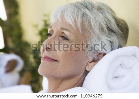 Portrait of a senior woman relaxing in a spa - stock photo
