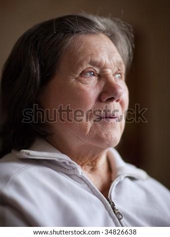 Portrait of a senior woman - shallow DOF - stock photo