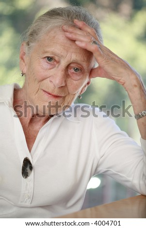 Portrait of a senior woman. Shallow DOF. - stock photo