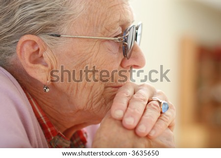 Portrait of a senior woman. Shallow DOF, focus on eye. - stock photo