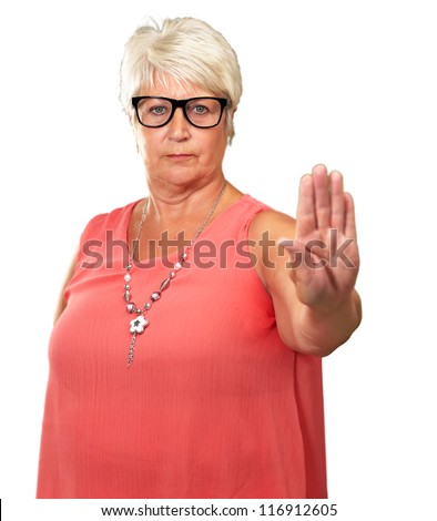 portrait of a senior woman showing stop sign on white background - stock photo
