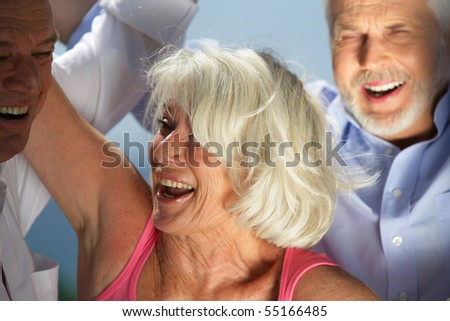 Portrait of a senior woman smiling - stock photo
