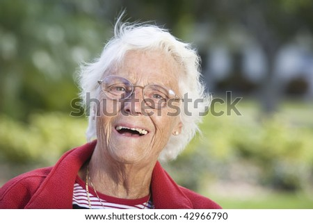 Portrait of a senior woman smiling. Horizontally framed shot. - stock photo
