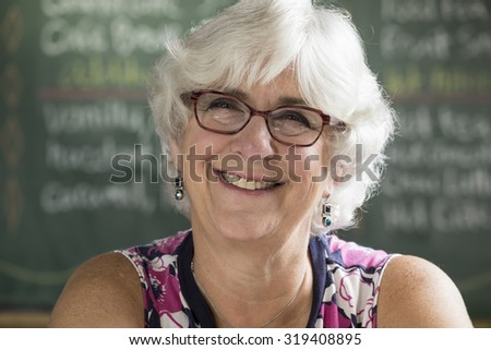 Portrait of a senior woman, smiling,looking at the camera - stock photo