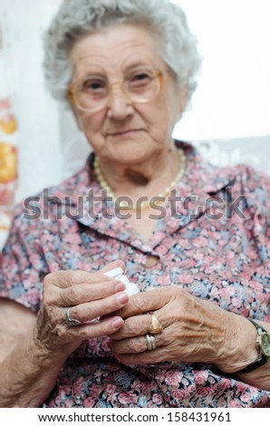 Portrait of a senior woman taking pill