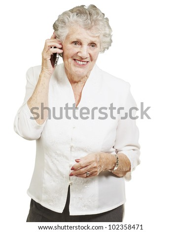 portrait of a senior woman talking on a mobile over a white background - stock photo