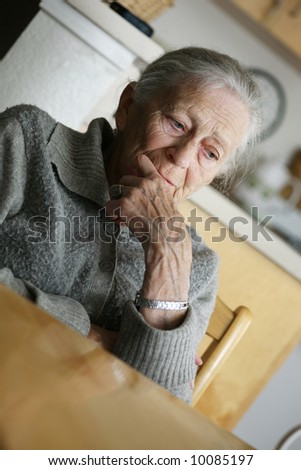 Portrait of a senior woman thinking. - stock photo