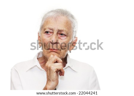 Portrait of a senior woman thinking - stock photo