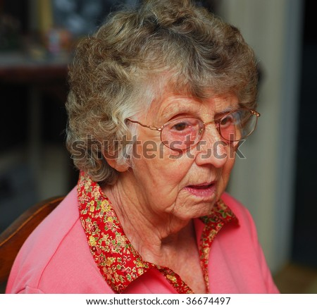 Portrait of a senior woman with a confused expression - stock photo