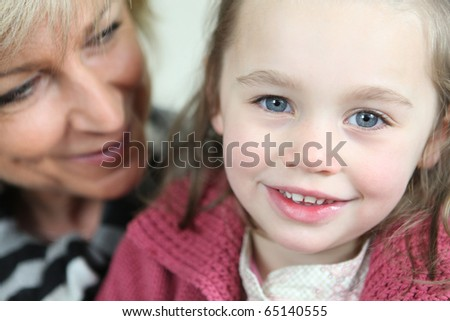 Portrait of a senior woman with a little girl
