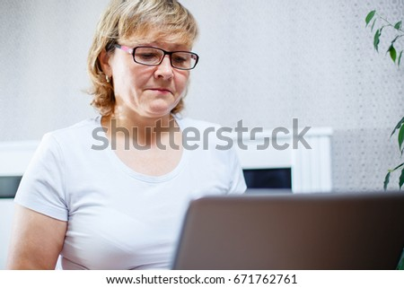 Portrait of a senior woman working on laptop