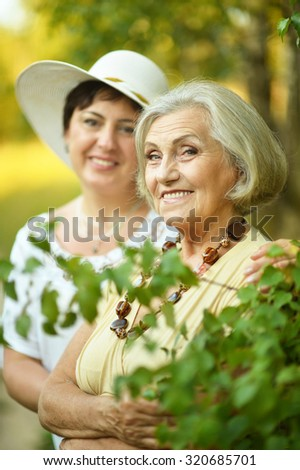 Portrait of a senior women resting at summer park