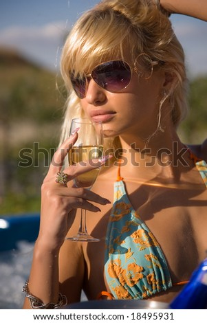 Portrait of a sensual girl in swimming suit and sunglasses - stock photo