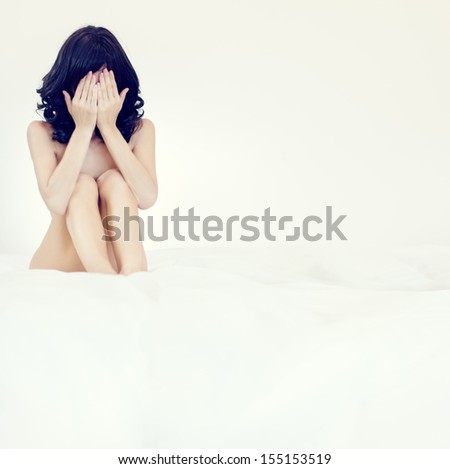 portrait of a sensual girl in white bed - stock photo