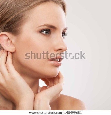 Portrait of a sensual girl with tender hands and face - stock photo