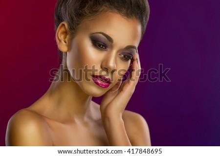 Portrait of a sensual young African woman - stock photo