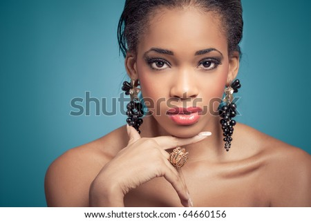Portrait of a sensual young model, isolated on blue - stock photo