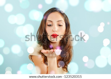portrait of a sensual young woman kissing. winter style. - stock photo