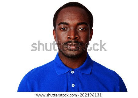 Portrait of a serious african man in blue t-shirt over white background