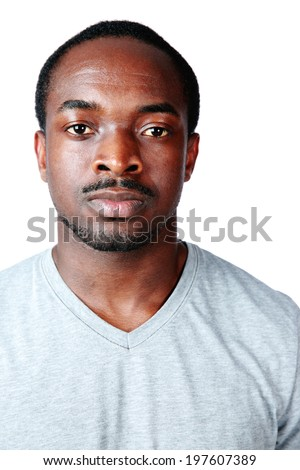 Portrait of a serious african man isolated on white background - stock photo