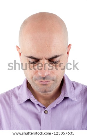 Portrait of a serious and worried  bald man looking down. Lilac shirt. Isolated. - stock photo