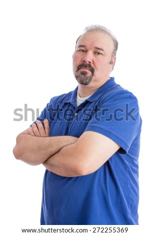 Portrait of a Serious Bearded Man in Blue Polo Shirt, Crossing his Arms and Looking at the Camera in an Aggressive Look. Isolated on White Background. - stock photo
