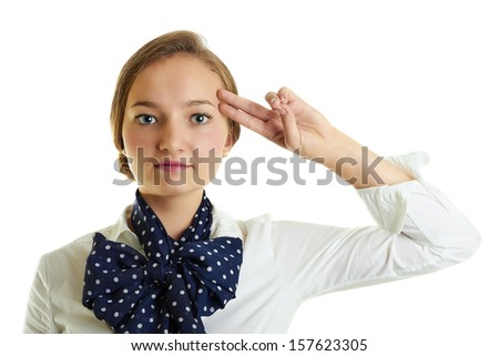 Portrait of a serious blonde girl dressed with a white shirt and blue scarf saluting as military isolated on white.