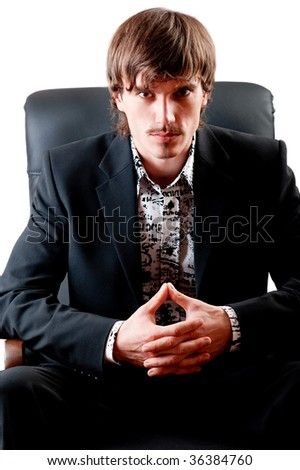 Portrait of a serious businessman sitting in a chair isolated on a white background - stock photo