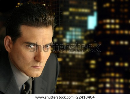Portrait of a serious businessman with night skyline behind him - stock photo