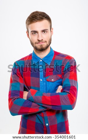 Portrait of a serious casual man standing with arms folded isolated on a white background - stock photo