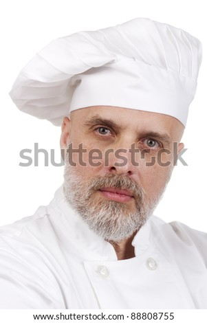 Portrait of a serious chef in a chef's hat.