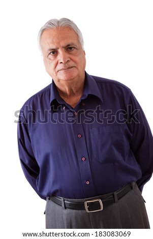 Portrait of a serious elderly East Indian man - stock photo