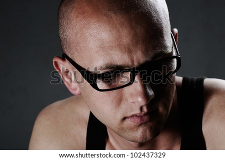 Portrait of a serious guy wearing glasses
