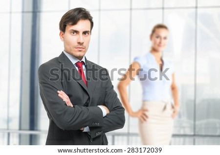 Portrait of a serious handsome businessman - stock photo