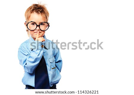 Portrait of a serious little boy in spectacles and suit. Isolated over white background.