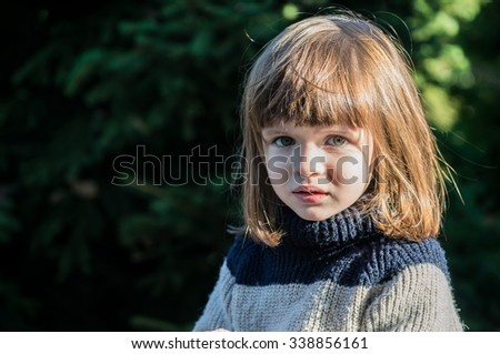 portrait of a serious little girl - stock photo