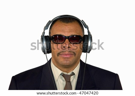portrait of a serious looking mature African-American man with headphones and sunglasses, isolated on white background